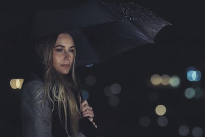 Lonely woman at night