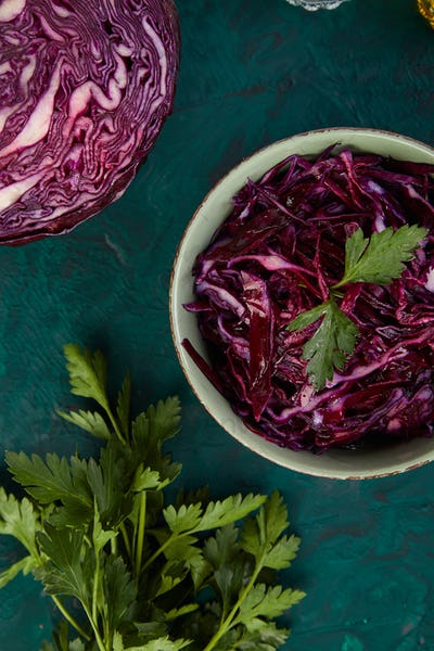 Shredded red cabbage in bowl.