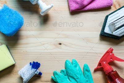 House cleaning tools on wooden background