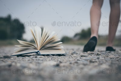 open book lying on the road