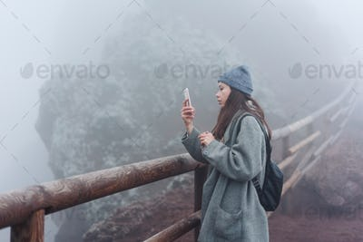 Girl climbs the path to the mountain