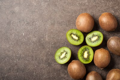 Fresh kiwi fruits on stone table