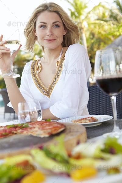 Woman Enjoying Meal In Outdoor Restaurant