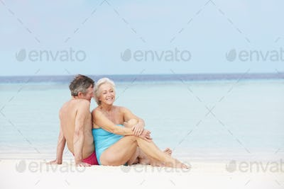 Senior Couple Relaxing On Beautiful Beach Together