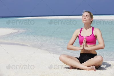 Woman Meditating On Beautiful Beach