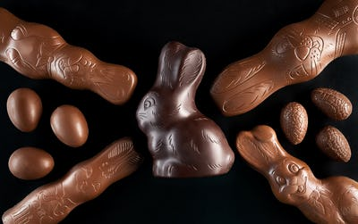 Chocolate Easter bunny and eggs on dark background