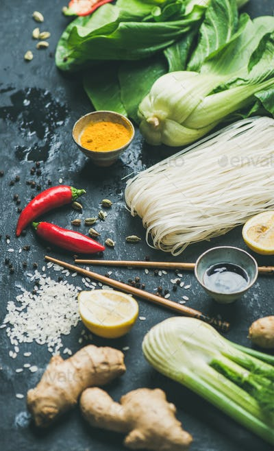 Asian cuisine ingredients over dark slate stone background, selective focus