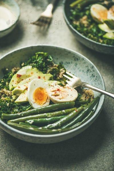 Healthy vegetarian breakfast bowls over concrete background