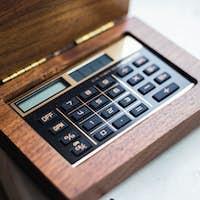 Calculator closeup on wooden background