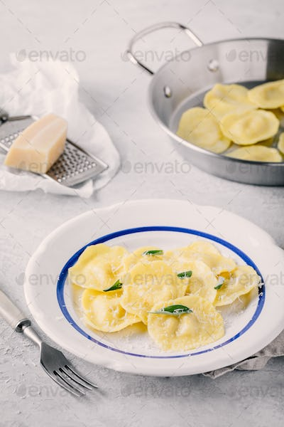 ravioli pasta with parmesan cheese and sage