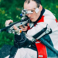 Male training sport shooting with free rifle