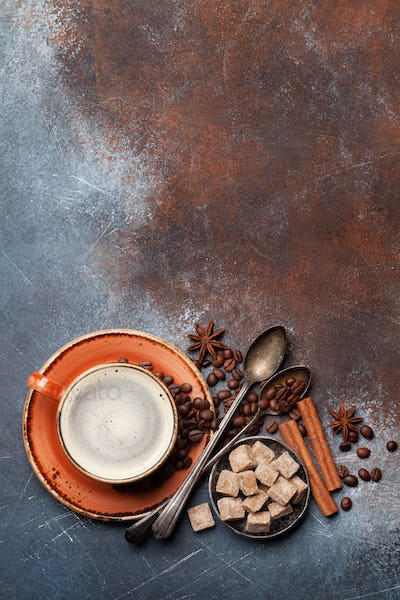 Coffee cup, beans, sugar and spices