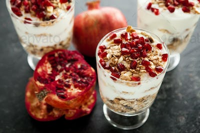 Three glasses with home-made desset made of muesli, yoghurt and