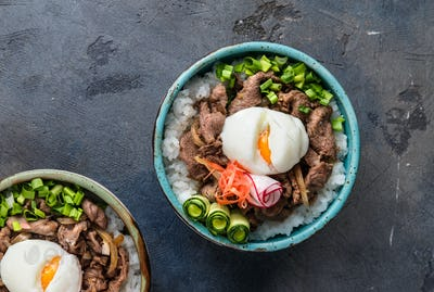 Gyudon - japanese rice and beef bowl on dark background