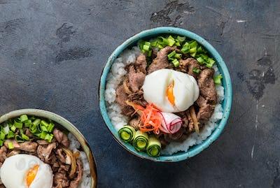 Gyudon - japanese rice and beef bowl on dark background