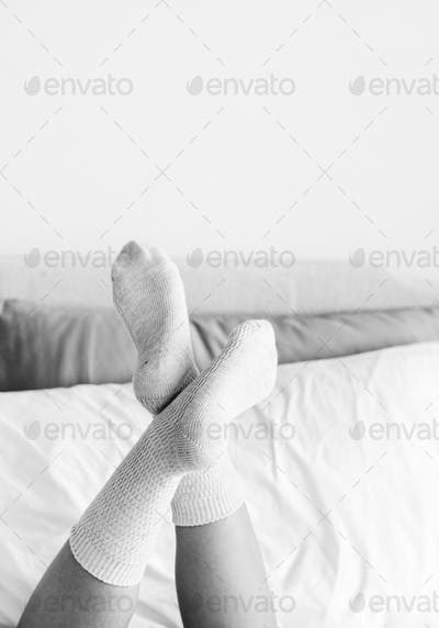Closeup of woman legs on bed