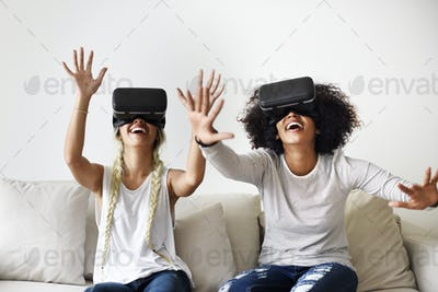 Girlfriends trying on VR headsets