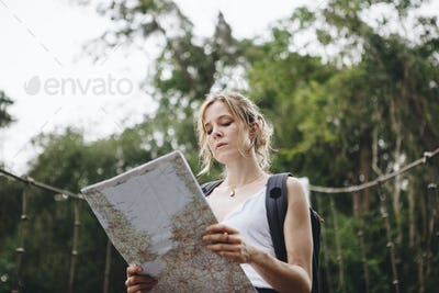 Caucasian woman looking at a map travel and explore concept