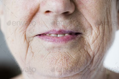 Portrait of white elderly woman closeup on smiling lips