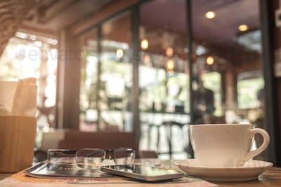 Coffee mug with cafe blurred background.