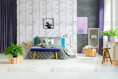 Birch tree wallpaper above bed