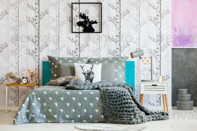 Bright bedroom with forest motif