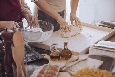 People making dough on board