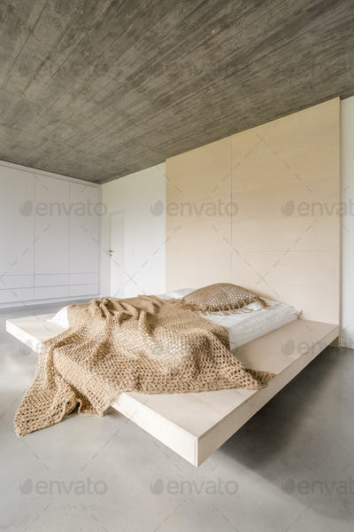 Bed on wooden platform
