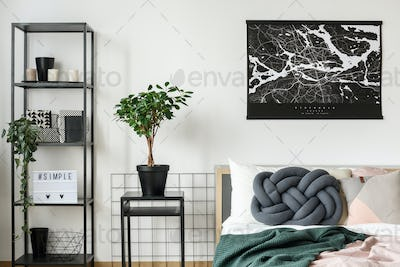 Black poster above king-size bed