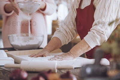 Close-up of person making cake