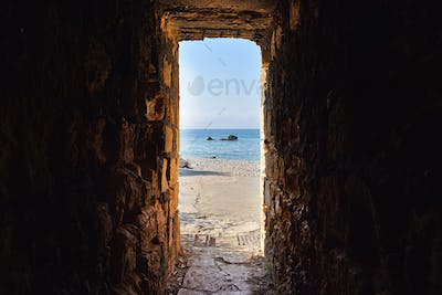 Sea view through ancient tunnel