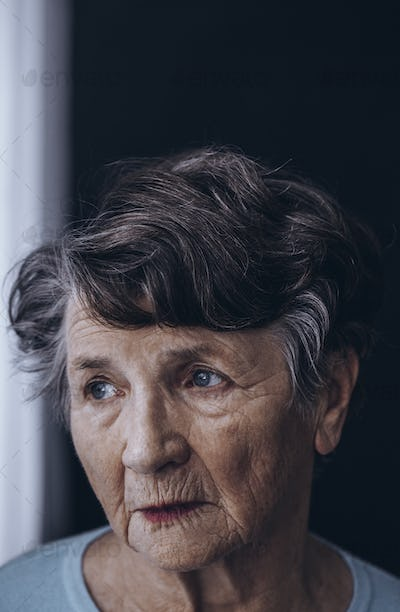 Old grandmother's face with wrinkles