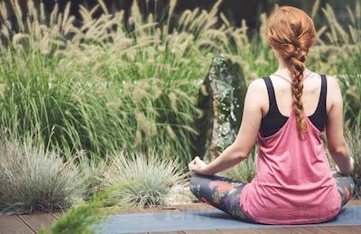Caucasian woman meditating