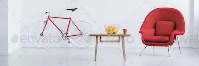 Red bike in stylish studio