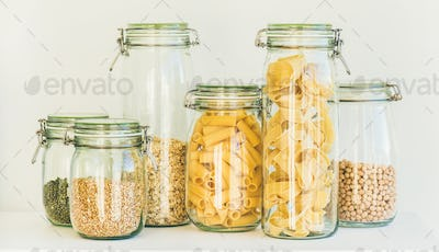 Uncooked cereals, grains, beans and pasta in jars