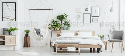 Spacious bedroom with wooden furniture