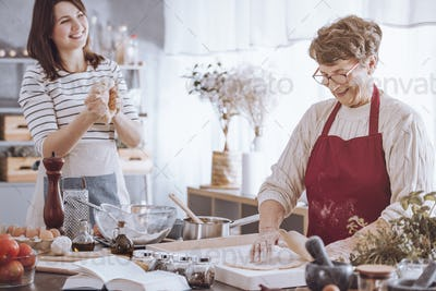 Women have fun while cooking