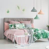 Pastel bedding on stylish bed