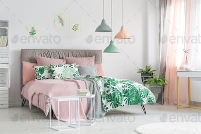Pastel bedding on stylish bed