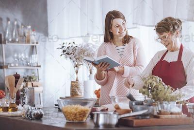Happy grandmother mixing ingredients