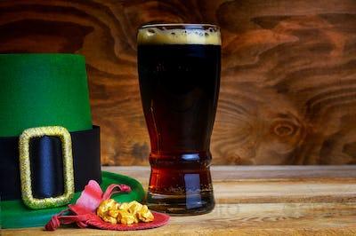 Saint Patrick day symbols green hat and leprechaun gold