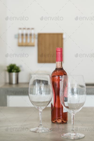 Rosé wine bottle with glasses