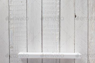 white shelf on wooden wall