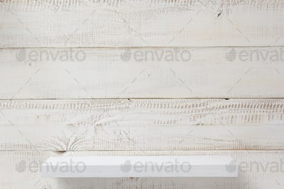 shelf at white plank wooden background