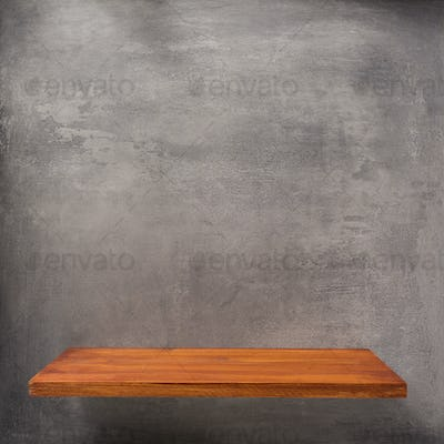wooden shelf at concrete wall