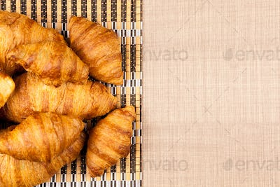 Close up top view on delicious fresh baked golden croissants
