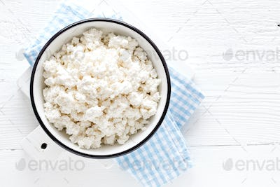 Cottage cheese, curd on white wooden rustic table, top view