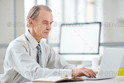 Aged office worker at office
