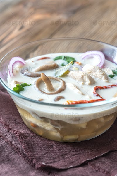 Glass bowl of thai tom kha kai