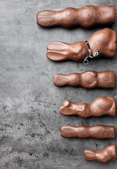Variety of chocolate Easter bunnies on rustic background